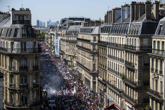 Image: Protesters fill a main thoroughfare during a rally against Macron