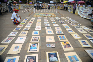 Image: The Madres de la Candelaria hold an event marking the 17th anniversary of the group's founding in Medellin