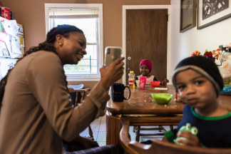 Image: Alia McCants FaceTimes her mother during breakfast at her home in White Plains, New York, May 8, 2018.