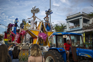 Image: Dancers and drag queens perform on a float pulled by a tractor during the annual LGBT pride parade