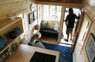 Here Guillaume Dutilh A Tumbleweed Workshop Host Poses On The Porch Of Brand Cypress 24 Model Tiny House