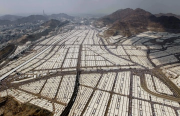 This aerial image made from a helicopter shows thousands of tents housing Muslim pilgrims crowded together in Mina during the annual Hajj in Mecca ... & Pilgrimage to Mecca