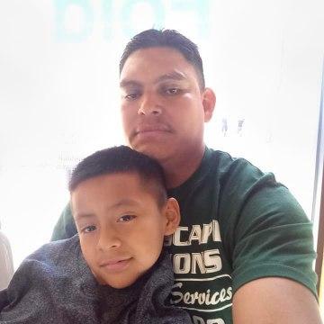 Ubaldo Ochoa Lopez and his 9-year-old son, Fernando.Courtesy RAICES Texas