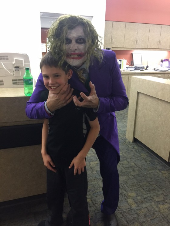 Dr. Joker poses with 10 year-old Brenden Selph as he prepares to deliver his baby sister