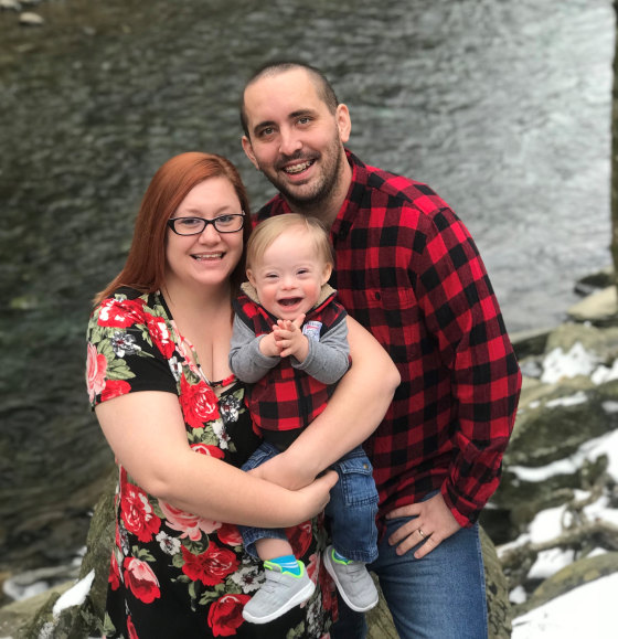 Lucas, 1, with his parents, Cortney and Jason Warren.