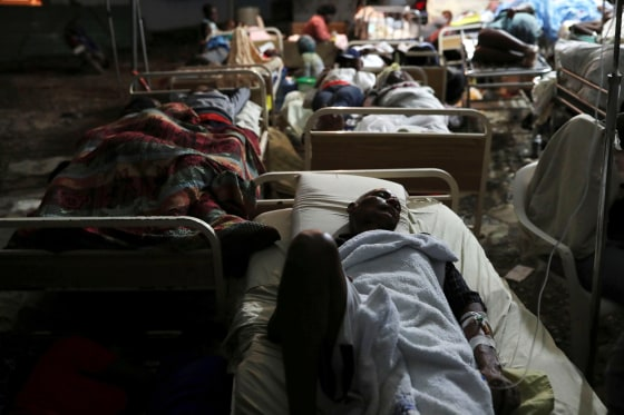 Image: People injured in an earthquake that hit northern Haiti late on Saturday, sleep in a tent, in Port-de-Paix