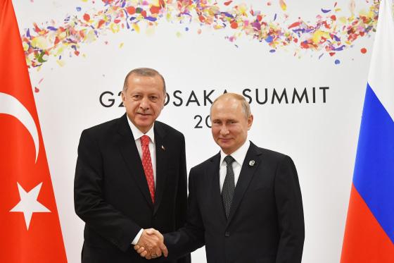 Image: Russian President Vladimir Putin greets Turkish President Recep Tayyip Erdogan on the sidelines of the G20 leaders summit in Osaka, Japa