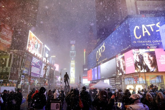 Snow squall covers New York in a sudden dusting of snow