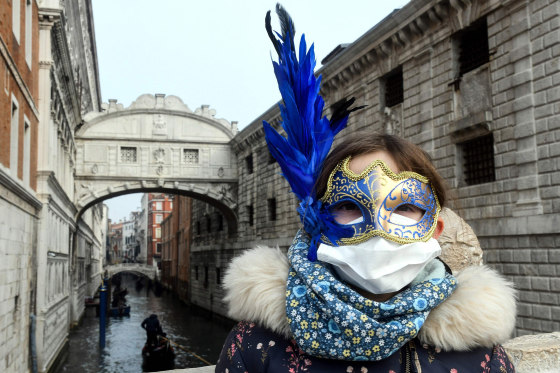 COVID-19 brings a new kind of mask to carnival in Venice (a medical face mask under the usual style of carnival mask).