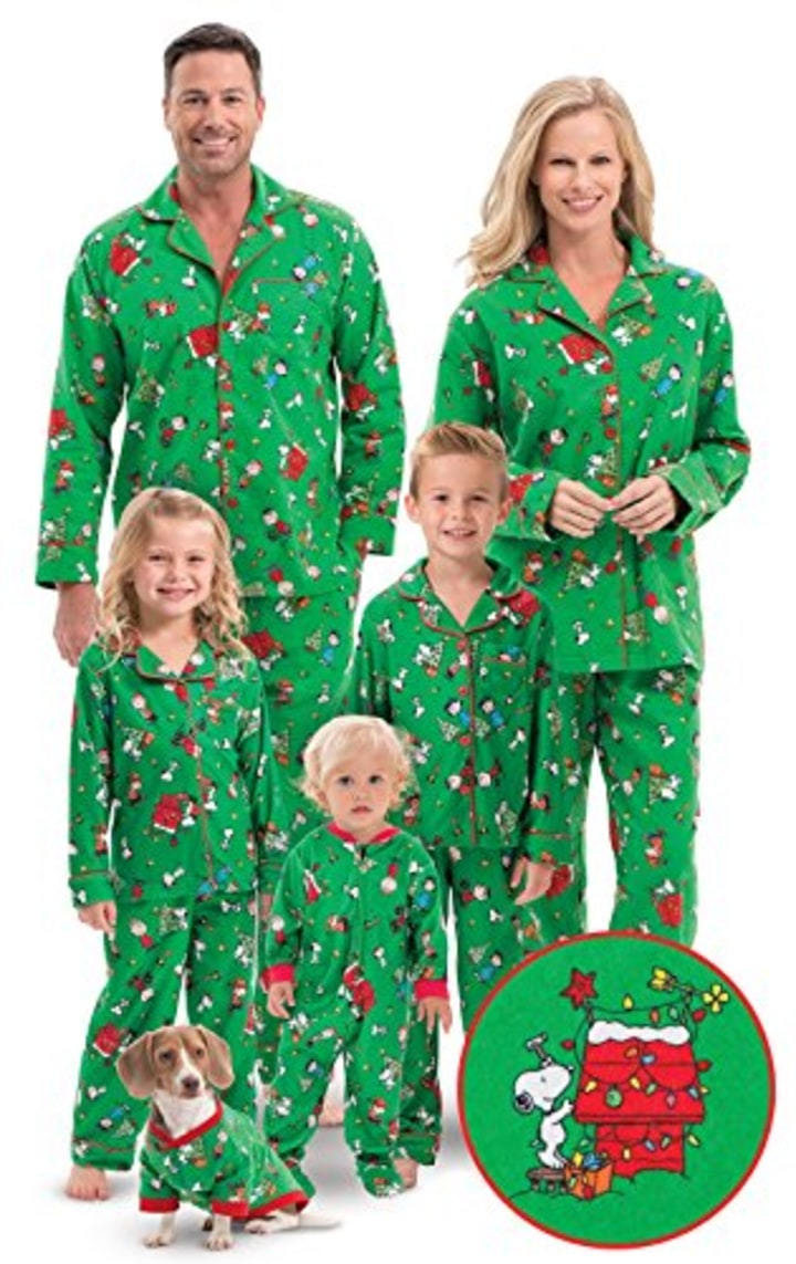 Family Christmas Pajamas With Dog.Dog Pajamas Allow Owners To Curl Up With Their Pets In