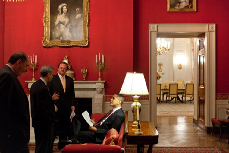 President Barack Obama with Senior Advisor David Axelrod, then-Chief of Staff Rahm Emanuel and Press Secretary Robert Gibbs in the Red Room of the White House prior to a press conference in March 2009. By February, all three staffers will have left the White House.