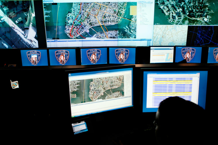 Image: Maps of lower Manhattan and camera views are displayed at the command center