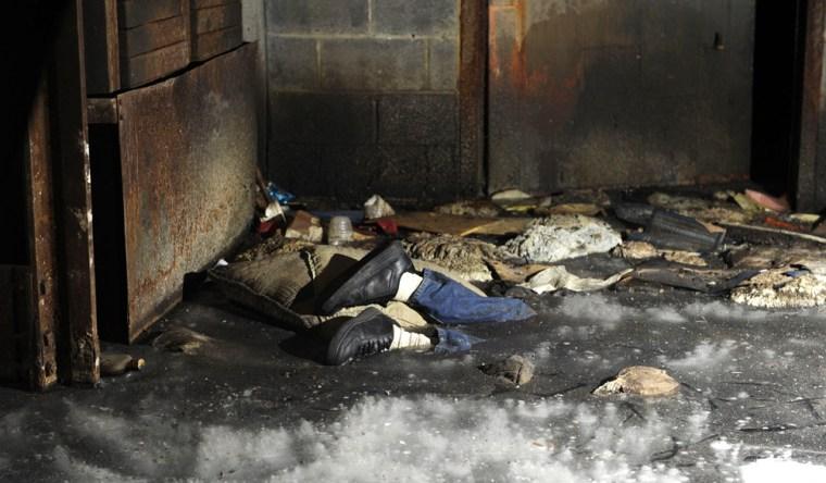 Image: dead body is seen frozen in a block of ice