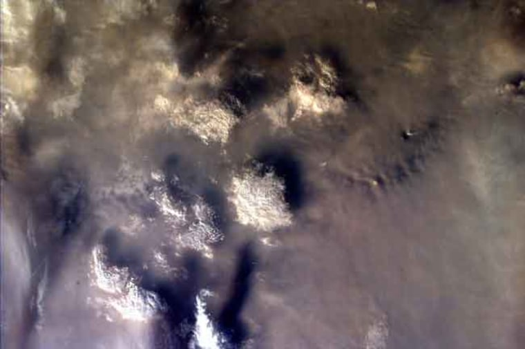 This satellite image shows smoldering underground fires that took place at Toba in 1997. A devastating volcanic eruption occurred at the site roughly 73,000 years ago.