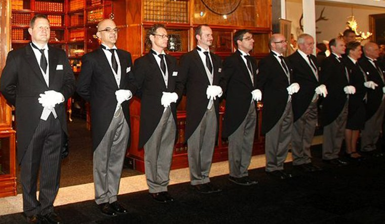 Butlers stand on display at the luxury market at Amsterdam's Millionaire Fair.