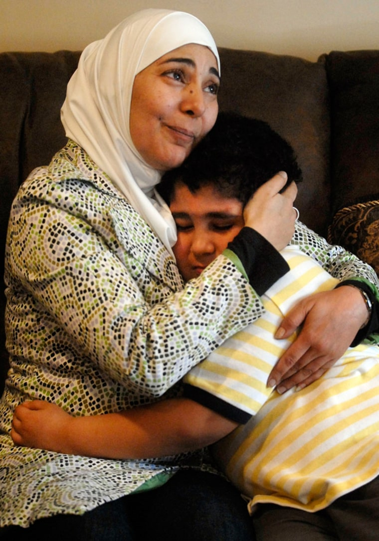 Image: Omar Mohammad, 6, hugs his mother Sana Alsaidy