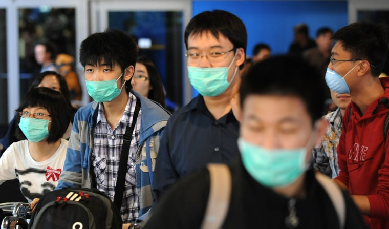 Image: Asian travellers at Los Angeles International Airport