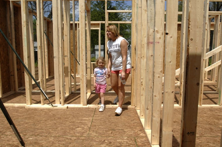 Lyric Strong shows her future new bedroom to her niece Lexie Strong. The Strongs are moving into a house in Elkhart, Ind., being built by Habitat for Humanity. The nonprofit on Thursday announced it is getting a $100 million gift from Atlanta developer J. Ronald Terwilliger.