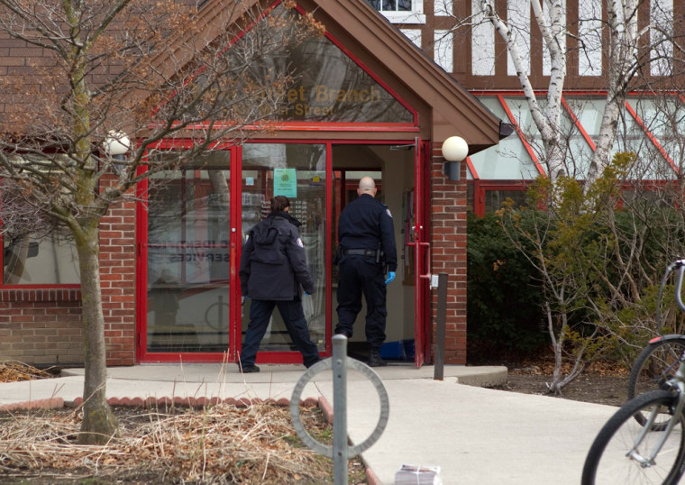 Image: A Canadian man has been charged with killing a man by shooting him in the back with a crossbow at the Toronto library