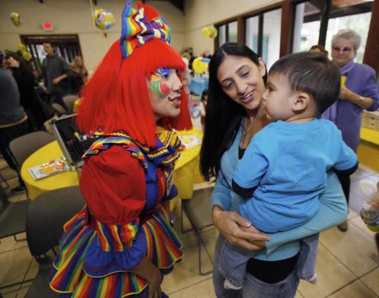 Image: Ooopsy the clown, Lisa Castillo, Nicholas Castillo