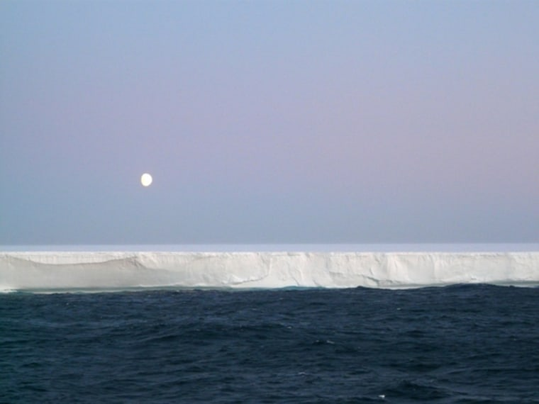 The moon shinesover an iceberg in the Weddell sea of Antarctica.
