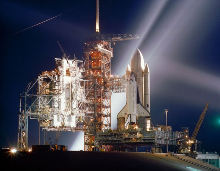 The space shuttle Columbia, NASA's first orbiter, is lit up in this night scene at Launch Pad 39A at the Kennedy Space Center in Cape Canaveral, Fla., during preparations for the first flight (STS-1) of NASA's new reusable spacecraft system. This photo was taken in March 1981 ahead of Columbia's April 12, 1981, launch.
