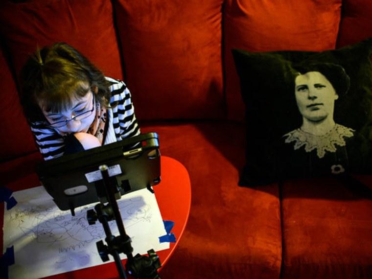 Image: Lillian Bosley, 13, watched cartoons on an iPad at her Myersville, Md., home. Lillian has Arthrogryposis multiplex congenita, a rare orthopedic disease.