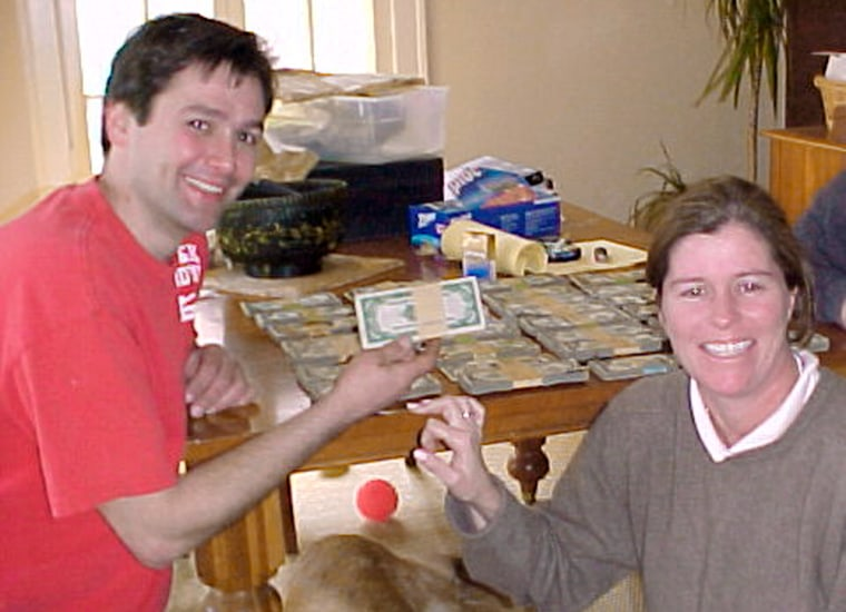 Image: Contractor Bob Kitts, left, and homeowner Amanda Reece