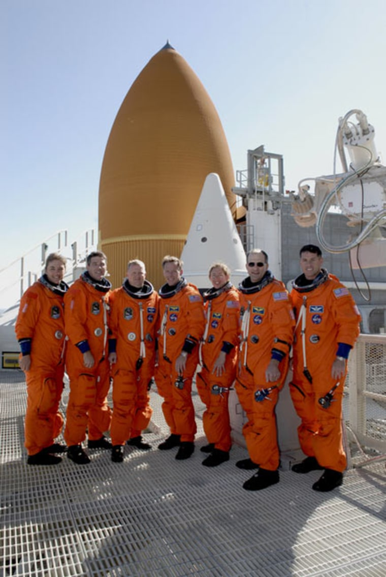 On the 225-foot level of Launch Pad 39A at NASA's Kennedy Space Center in Florida, the STS-126 crew poses for a group photo as they prepare for a Nov. 14, 2008 launch. From left are Mission Specialists Heidemarie Stefanyshyn-Piper and Steve Bowen, Pilot Eric Boe, Commander Chris Ferguson, and Mission Specialists Sandra Magnus, Donald Pettit and Shane Kimbrough. Credit: NASA/Troy Cryder