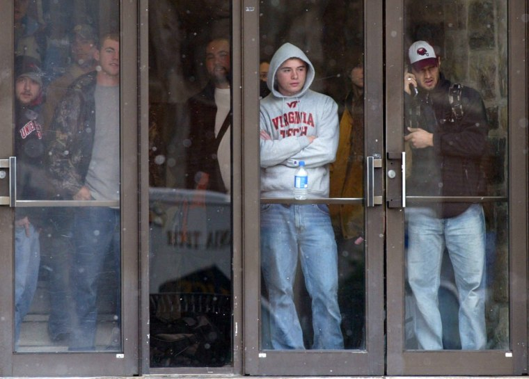 Image: Virginia Tech students look out from a doorway