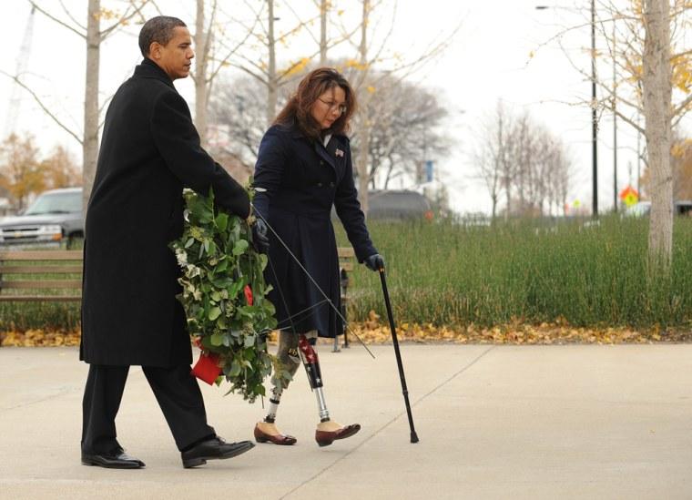 Image: Barack Obama and Tammy Duckworth lay a wreath