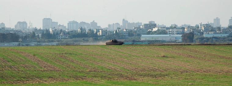 Image: An Israeli tank patrols along the Israeli-Gaza border