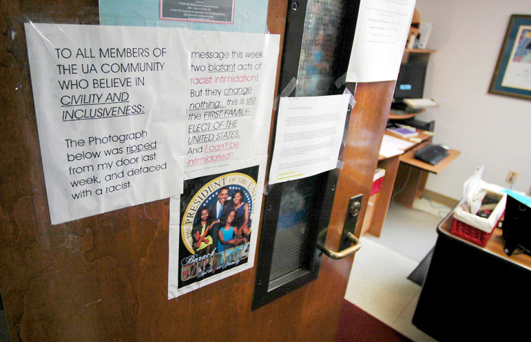 University of Alabama professor Marsha L. Houston posted a message against racism on Thursday after someone defaced a previous poster of President-elect Barack Obama and his family with a death threat and racial slurin Tuscaloosa, Ala.