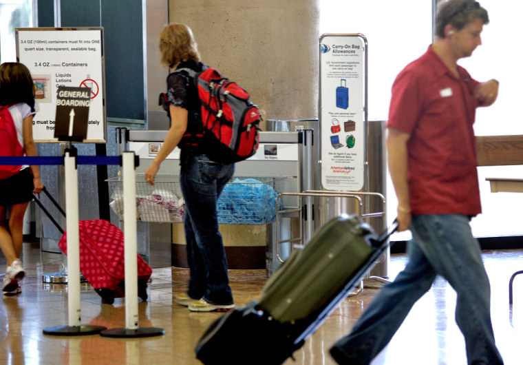 Image: Passengers move around Sky Harbor International Airport