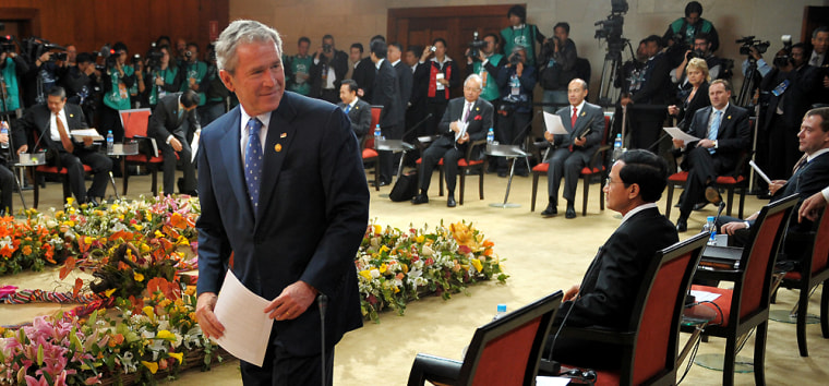President Bush takes his seat during the Asia-Pacific Economic Cooperation summit Sunday.