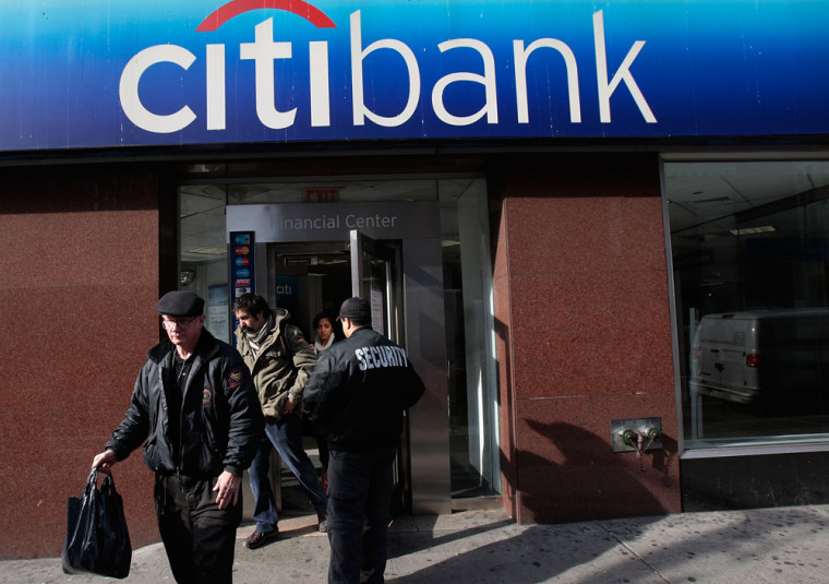 Image:  People walk out of a Citibank branch