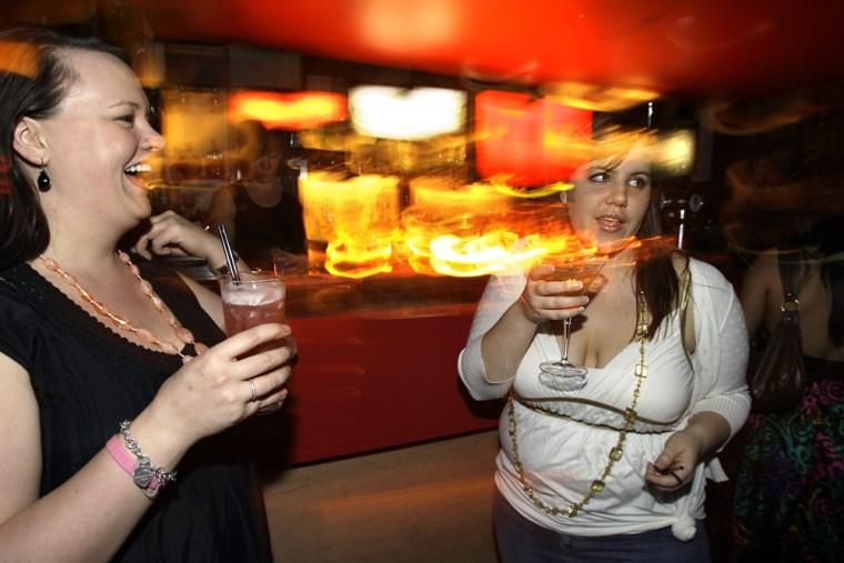 Sarah Watson left, and Erin Marsh enjoy a cocktails at Melt bar in Sydney's Kings Cross nightclub district inAustralia on Oct. 24.
