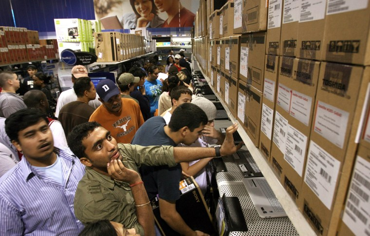 Rohith Bevavelli works his way through the crowd of shoppers to get to the laptop section at Best Buy in Corpus Christi, Texas, to take advantage of Black Friday deals.