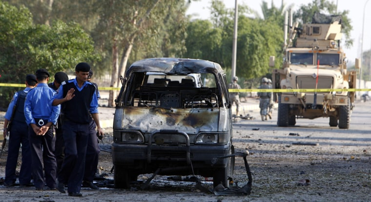 Image: US soldiers and Iraqi police secure site of bomb attacks in eastern Baghdad