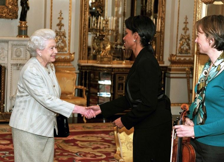 Image: Britain's Queen Elizabeth II, left, shakes hands with Condoleezza Rice
