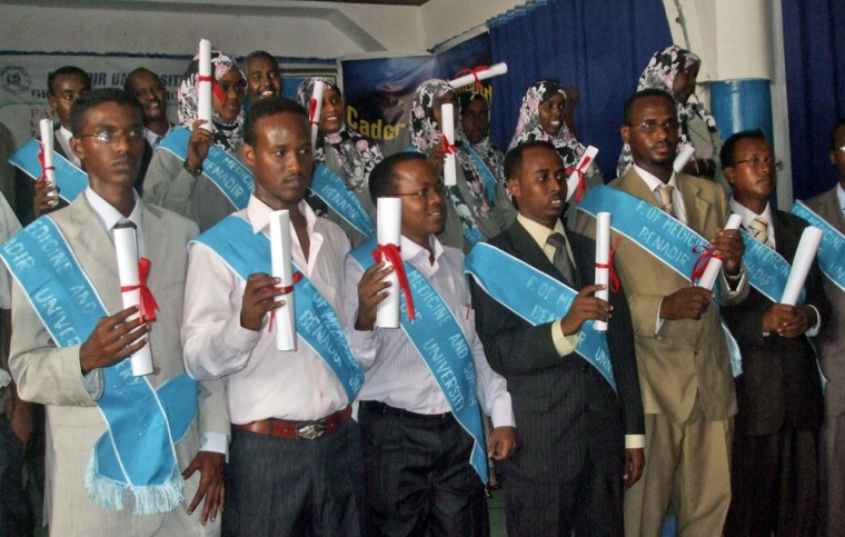 Image: Newly qualified Somali doctors hold their certificates