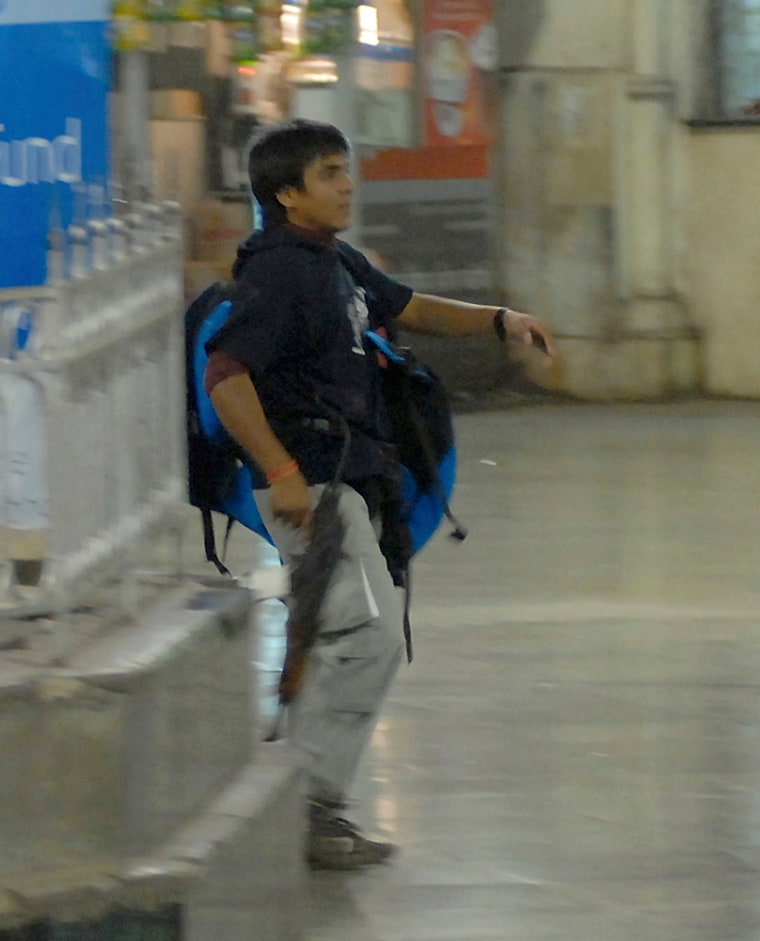 Mohammed Ajmal Kasab, 21, walks the Chatrapathi Sivaji Terminal railway station in Mumbai, India, on Nov. 26. He was one of the 10 men who attacked some of Mumbai's best known landmarks in a bloody siege that killed 171.