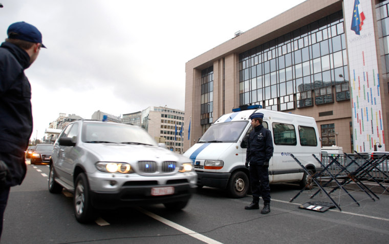 Image: Belgian police officers outside the European Council headquarters at the start of a two-day EU leaders summit in Brussels