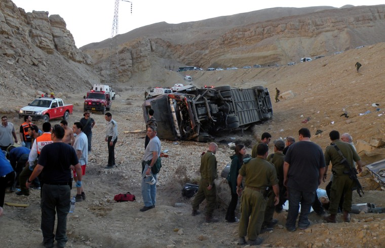 Image: Israeli soldiers and emergency personnel stand on scene of crash north of Eilat