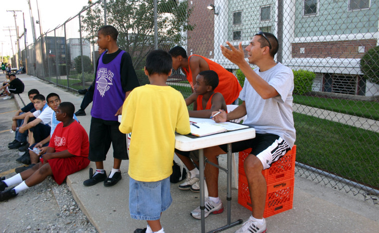 Rob Castañeda, right, with some of the kids in his Beyond the Ball program.