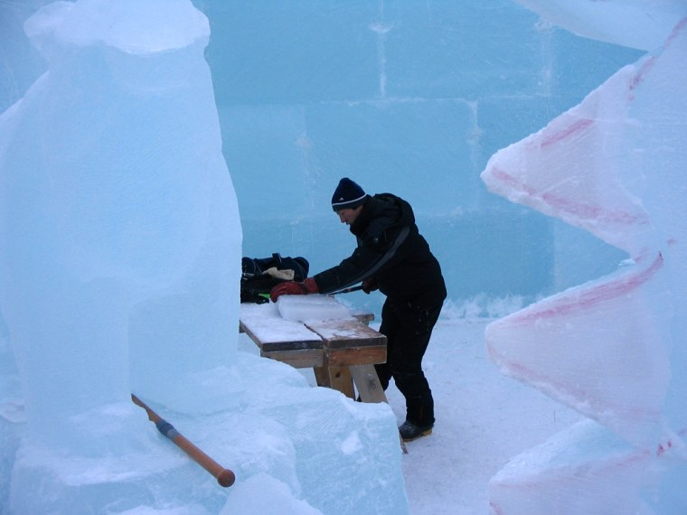 A worker carves a block of ice at Fairbanks' Ice Park in Fairbanks,
