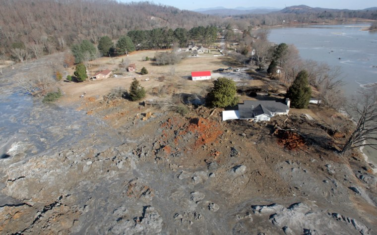 This Dec. 22, 2008, aerial view shows homes that were destroyed when a retention pond wall collapsed at the Tennessee Valley Authority's Kingston Fossil Plant, in Harriman, Tenn.