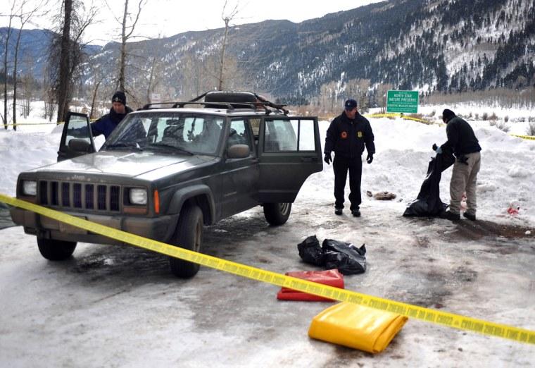 Image: bomb squad searches Jeep
