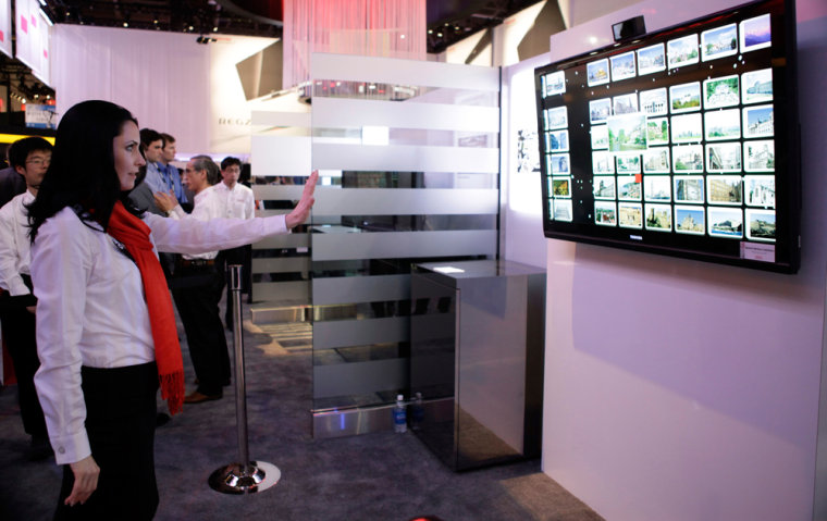 Image: A booth hostess demonstrates Spatial Motion Interface