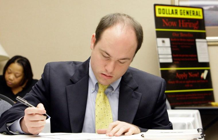 Image: Steve Pruitt fills out an employment application